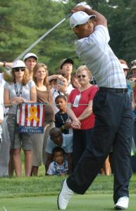 070704-N-2855B-005 Tiger Woods, Champion Golfer, drives the ball down range during the inaugural Earl Woods Memorial Pro-Am Tournament, part of the AT&T National PGA Tour event, July 4, 2007, at the Congressional Country Club in Bethesda, MD.  Woods donated 30,000 tournament tickets to military personnel to attend the event honoring soldiers and military families. Defense Dept. photo by Petty Officer 2nd Class Molly A. Burgess, USN.